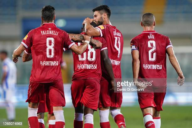 Christian Kouan of AC Perugia celebrates with teammates after scoring a goal during the serie B Play-Out first leg match between Pescara Calcio and...