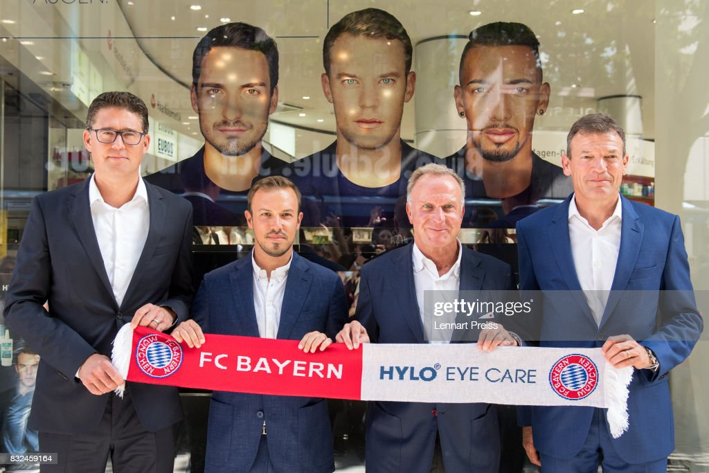 Christian Krensel (L-R), Global Director Marketing & Sales of Ursapharm, Dominik Holzer, CEO of Ursapharm, Karl-Heinz Rummenigge, CEO of FC Bayern Muenchen AG and Andreas Jung, Executive Board Member of FC Bayern Muenchen, pose for the photographers infront of a pharmacy during the presentation of the new partnership of FC Bayern Muenchen and HYLO Eye Care on August 16, 2017 in Munich, Germany.
