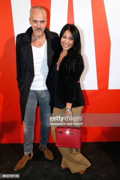 Christian Kretschmar and singer Anggun attend the Art Exhibition Reflexion Redux of Benjamin Millepied and Barbara Kruger at Studio des Acacias on...