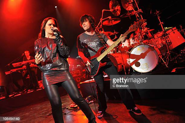 Christian Kretschmar, Tarja Turunen and Kevin Chown perform on stage at Shepherds Bush Empire on October 13, 2010 in London, England.