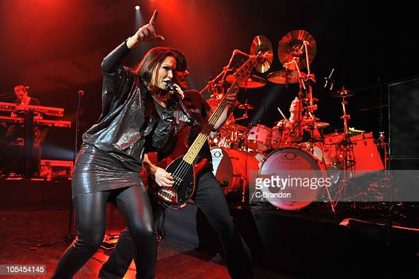 Christian Kretschmar, Tarja Turunen, Kevin Chown and Mike Terrana perform on stage at Shepherds Bush Empire on October 13, 2010 in London, England.