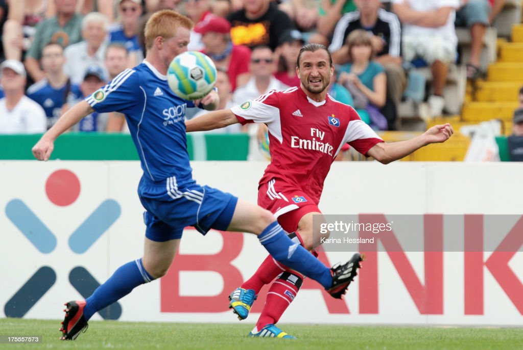 Christian Kretzer of Jena and Petr Jiracek of Hamburg battle for the ball during the DFB Cup between SV Schott Jena and Hamburger SV at Ernst-Abbe-Sportfeld on August 04, 2013 in Jena, Germany.