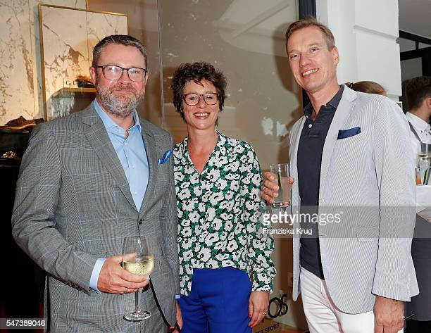 Christian Krug Ina Krug and Nils Behrens attend the Apropos Menswear Store Opening in Hamburg on July 14 2016 in Hamburg Germany
