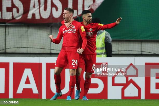 Christian Kuehlwetter of 1. FC Kaiserslautern celebrates with Hikmet Ciftci after scoring his team's first goal during the DFB Cup round of sixteen...