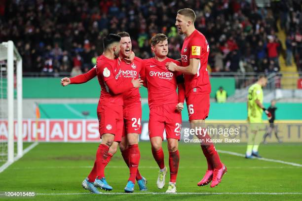 Christian Kuehlwetter of 1. FC Kaiserslautern celebrates with his team mates after scoring his team's second goal during the DFB Cup round of sixteen...
