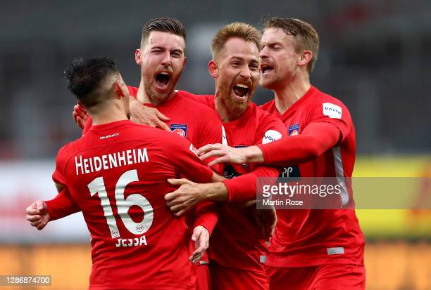 Christian Kuehlwetter of Heidenheim celebrate with his team mates after he scores his team's equalizing goal during the Second Bundesliga match...