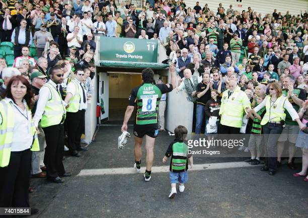 Christian Labit of Northampton applauds the fans as he walks from the pitch, after his team were relegated from the Guinness Premiership following...