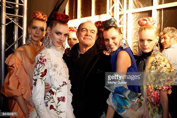 Christian Lacroix and models pose backstage during the Christian Lacroix fashion show during Paris Fashion Week Haute Couture Spring/Summer 2009 on...