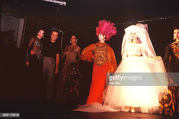 Christian Lacroix and models walks the runway during la Finale of a Jean Patou by Christian Lacroix fashion show at Les Bains Douches in 1985 in...