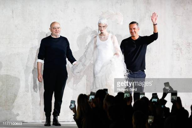 Christian Lacroix Dries Van Noten and a model acknowledge the audience during the Dries Van Noten Womenswear Spring/Summer 2020 show at Opera...