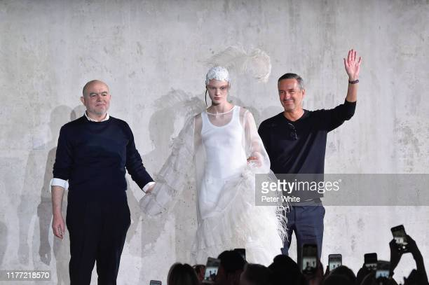 Christian Lacroix, Dries Van Noten and Vilma Sjöberg acknowledge the audience during the Dries Van Noten Womenswear Spring/Summer 2020 show as part...