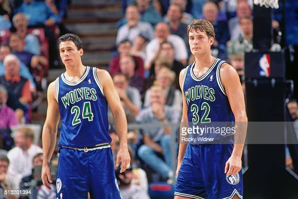 Christian Laettner and Tom Gugliotta of the Minnesota Timberwolves look on against the Sacramento Kings circa 1996 at Arco Arena in Sacramento...