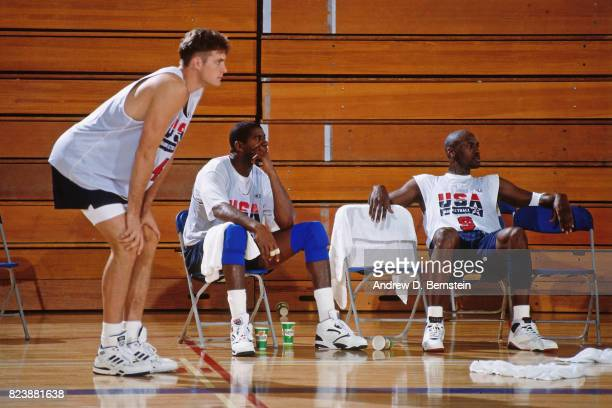 Christian Laettner Magic Johnson and Michael Jordan of the United States Basketball Team look on during practice at the 1992 Olympics in Barcelona...