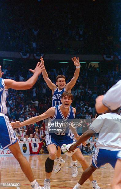 Christian Laettner of Duke Blue Devils yells out his jubilation after scoring the winning overtime basket against Connecticut Huskies. Teammate Bobby...