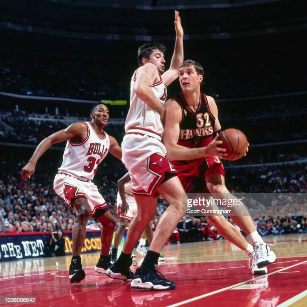 Christian Laettner of the Atlanta Hawks handles the ball during the game against the Chicago Bulls on May 8 1997 at the United Center in Chicago IL...