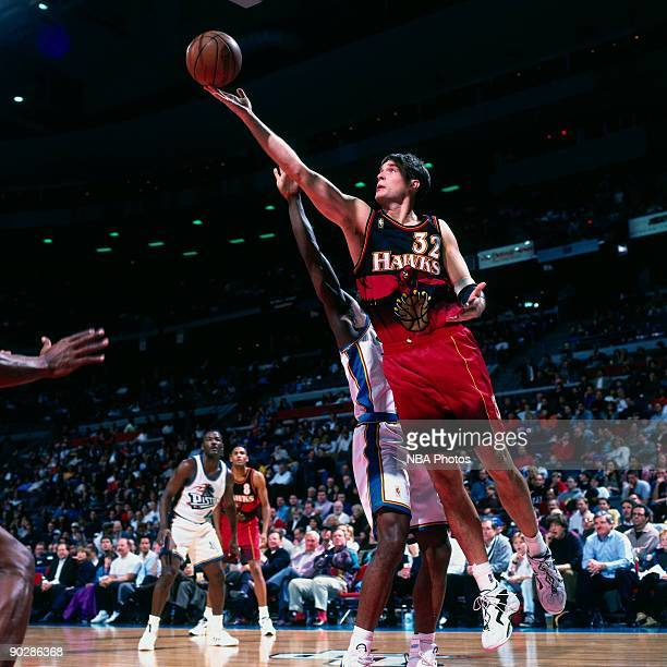 Christian Laettner of the Atlanta Hawks shoots a layup against the Detroit Pistons played in 1997 at the Palace of Auburn Hills in Auburn Hills...