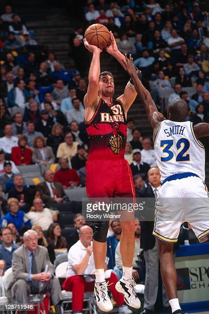 Christian Laettner of the Atlanta Hawks shoots against Joe Smith of the Golden State Warriors on February 4 1997 at San Jose Arena in San Jose...