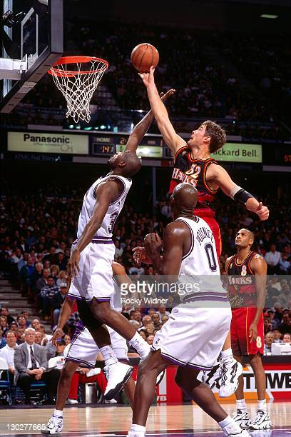 Christian Laettner of the Atlanta Hawks shoots against Michael Smith of the Sacramento Kings on November 7 1996 at Arco Arena in Sacramento...