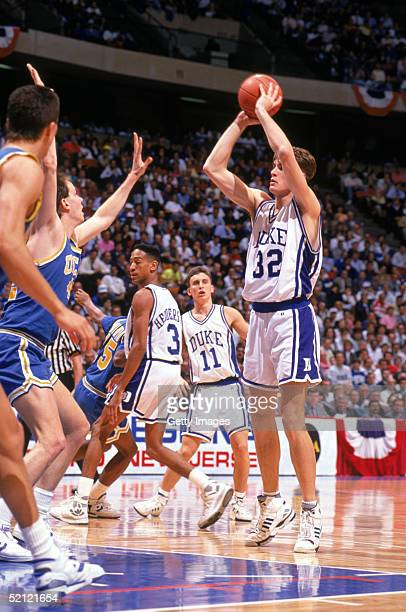 Christian Laettner of the Duke University Blue Devils looks to pass during an NCAA game in 1990.