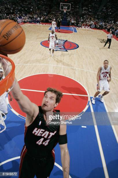 Christian Laettner of the Miami Heat shoots a layup against the Detroit Pistons during the game at the Palace of Auburn Hills on December 30, 2004 in...