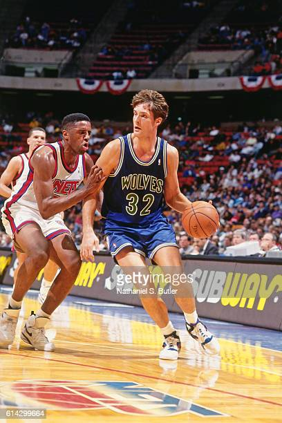Christian Laettner of the Minnesota Timberwolves dribbles against the New Jersey Nets during a game played circa 1993 at the Brendan Byrne Arena in...