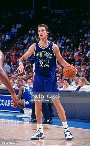 Christian Laettner of the Minnesota Timberwolves dribbles the ball during a game against the Sacramento Kings circa 1993 at the ARCO Arena in...