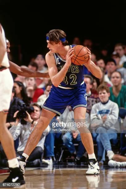Christian Laettner of the Minnesota Timberwolves drives against the Denver Nuggets circa 1994 at the McNichols Sports Arena in Denver Colorado NOTE...