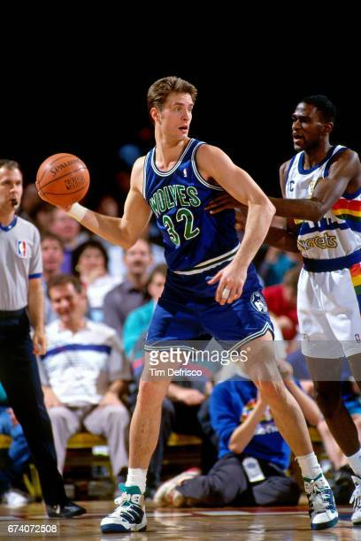 Christian Laettner of the Minnesota Timberwolves passes the ball against the Denver Nuggets circa 1995 at McNicholls Arena in Denver Colorado NOTE TO...