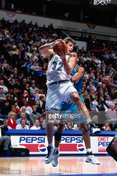 Christian Laettner of the Minnesota Timberwolves rebounds the ball against the Vancouver Grizzlies on March 17 1996 at the Target Center in...