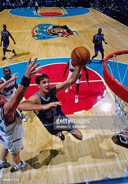 Christian Laettner of the Minnesota Timberwolves shoots against the Vancouver Grizzlies during a game played on November 5 1995 at General Motors...