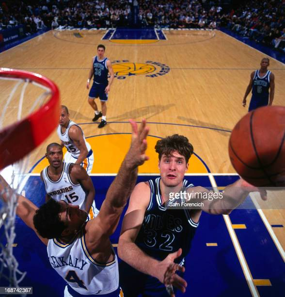 Christian Laettner of the Minnesota Timberwolves shoots the ball against the Golden State Warriors circa 1996 at the OaklandAlameda County Coliseum...