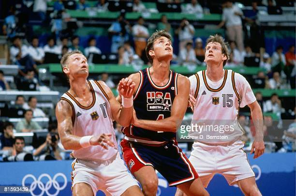 Christian Laettner of the United States boxes out against Detlef Schrempf of Germany during the 1992 Olympics in Barcelona Spain NOTE TO USER User...