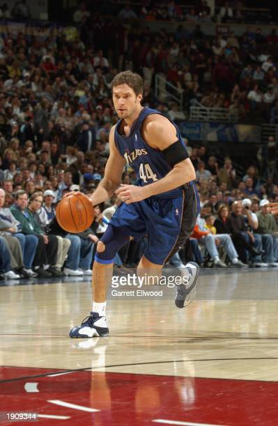 Christian Laettner of the Washington Wizards drives the ball during the NBA game against the Denver Nuggets at Pepsi Center on March 30 2003 in...