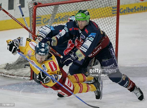 Christian Laflamme of Nuremberg checks Jeff Panzer of Dusseldorf during the DEL Play Off semi final match between Sinupret Ice Tigers and DEG Metro...