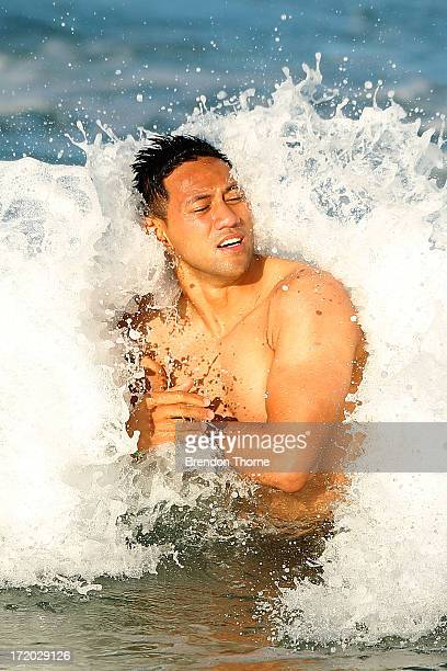Christian Leali'ifano is hit by a wave during an Australian Wallabies recovery session at Coogee Beach on July 1, 2013 in Sydney, Australia.