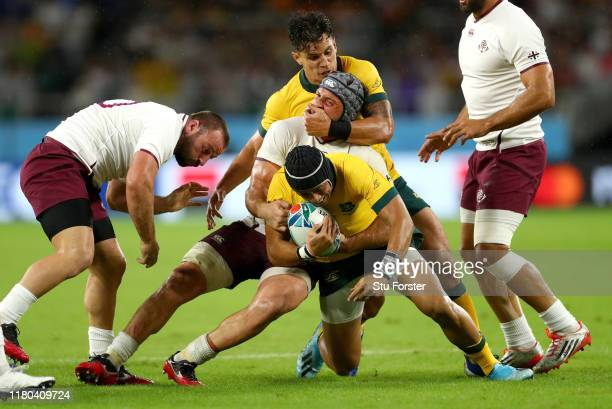 Christian Lealiifano of Australia is tackled by Beka Gorgadze of Georgia during the Rugby World Cup 2019 Group D game between Australia and Georgia...