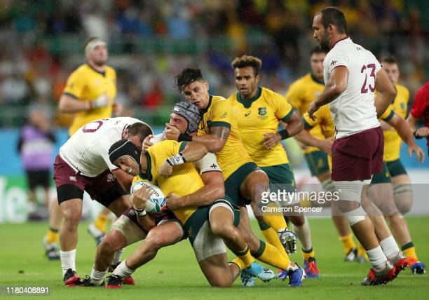 Christian Lealiifano of Australia is tackled during the Rugby World Cup 2019 Group D game between Australia and Georgia at Shizuoka Stadium Ecopa on...