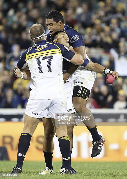 Christian Lealiifano of the Brumbies is congratulated by team mates after kicking a goal to win the game during the round seven Super Rugby match...