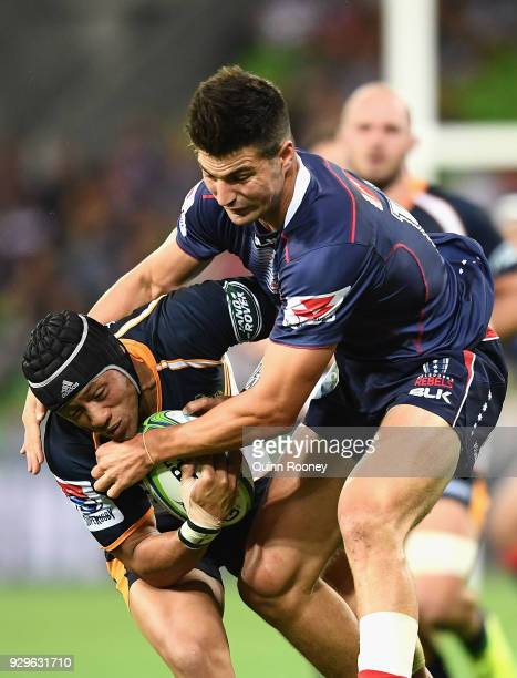 Christian Lealiifano of the Brumbies is tackled by Jack Maddocks of the Rebels during the round four Super Rugby match between the Rebels and the...