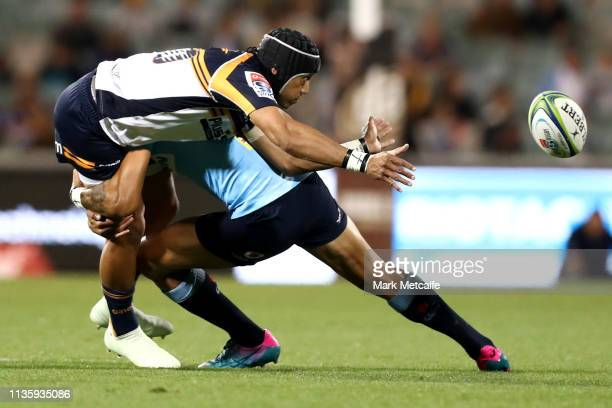 Christian Leali'ifano of the Brumbies offloads during the round five Super Rugby match between the Brumbies and the Waratahs at GIO Stadium on March...