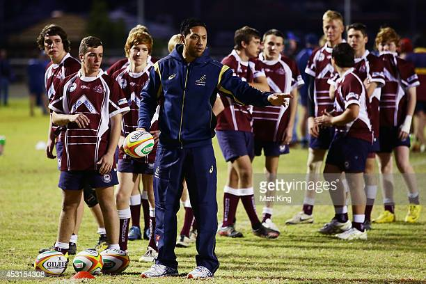 Christian Leali'ifano of the Wallabies coaches young rugby players during an Australian Wallabies coaching clinic on August 4 2014 in Dubbo Australia