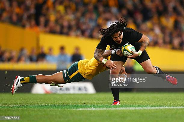 Christian Lealiifano of the Wallabies tackles Ma'a Nonu of the All Blacks during The Rugby Championship Bledisloe Cup match between the Australian...