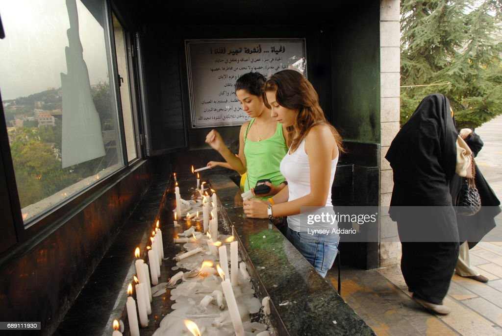Christian Lebanese and Iranian Muslims light candles side by side at the Lady of Lebanon Shrine and the Statue of The Virgin Mary outside of Beirut, Lebanon, September 20, 2006. The shrine, erected in 1908, has traditionally been a visiting place for people of all religions.