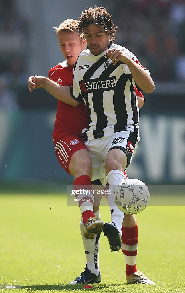 Christian Lell of Munich in action with Federico Insua of Monchengladbach during the Bundesliga match between Borussia Monchengladbach and Bayern Munich at the Borussia Park on May 5, 2007 in Monchengladbach, Germany.
