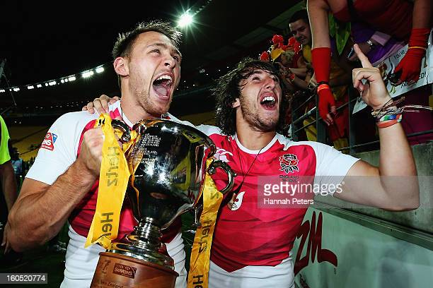Christian Lewis-Pratt celebrates with Dan Bibby of England after winning the grand final between England and Kenya during the 2013 Wellington Sevens...