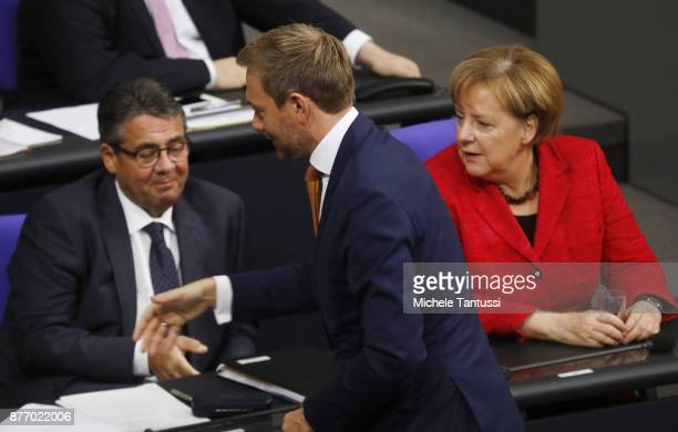 Christian Lindner Chairman of the FDP Party greets Foreign Minister Sigmar Gabriel and German Chancellor and leader of the German Christian Democrats...