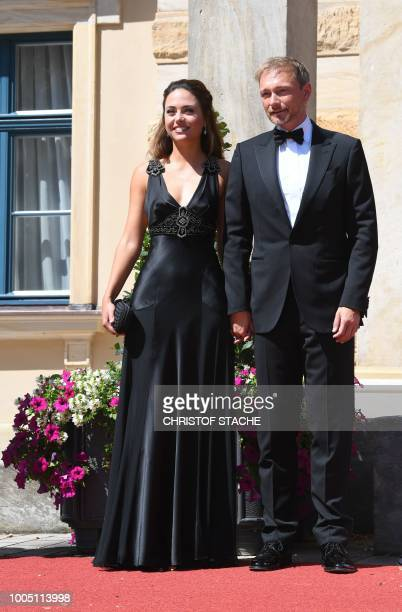 Christian Lindner head of the Free Democratic Party arrives with his girlfriend Franca Lehfeldt for the opening of the annual Bayreuth Festival...