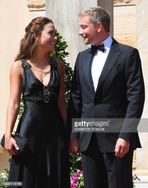 Christian Lindner , head of the Free Democratic Party arrives with his girlfriend Franca Lehfeldt for the opening of the annual Bayreuth Festival...