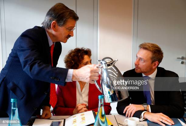 Christian Lindner head of the Free Democratic Party is offered some coffee by FDP treasurer Hermann Otto Solms as the SecretaryGeneral of the Free...