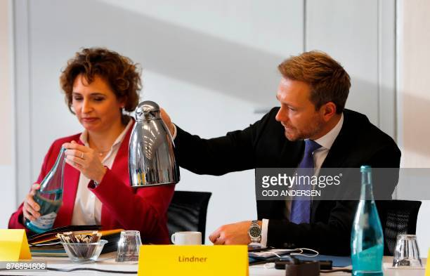 Christian Lindner head of the Free Democratic Party offers coffee to the SecretaryGeneral of the Free Democratic Party Nicola Beer prior to a...